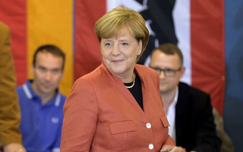 Результаты выборов вГермании: возникла реакция Меркель
